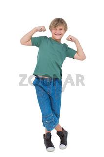 Happy blonde boy tensing arm muscles