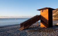 Lifeguard wooden tower at sunrise. Empty beach Pissouri Cyprus
