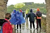 Spain: Pilgrims in the rain in Portomarin