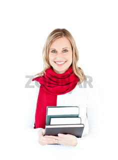 Portrait of a beautful woman with a red scarf holding books and smiling at the camera against a white background
