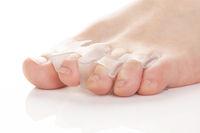 Silicone finger separator. Orthopedic toe corrector on white background.