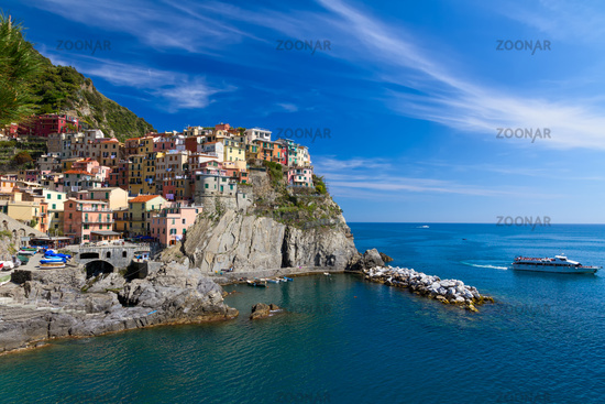 Village of Manarola with ferry, Cinque Terre, Ital