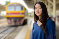 Young beautiful Asian tourist woman at the railway station