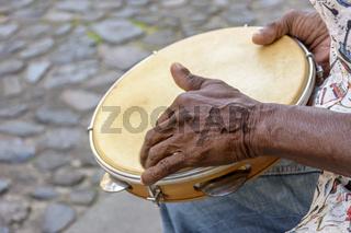 Brazilian samba performance with musician playing tambourine at Salvador, Bahia