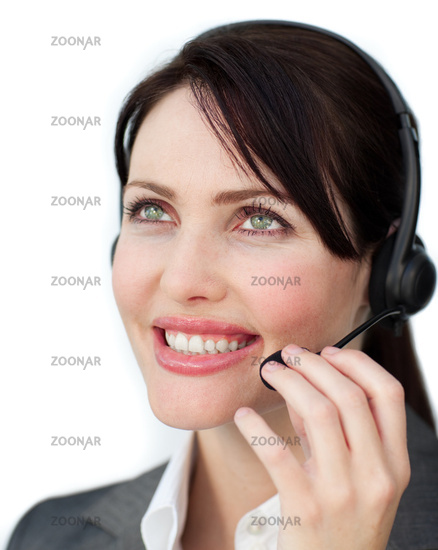 Positive customer service agent using headset against a white background