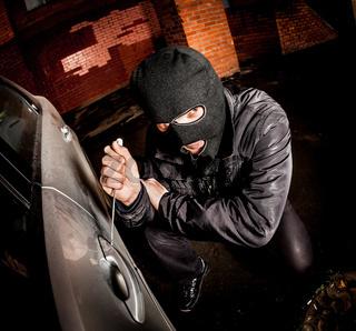 Car thief in a mask.