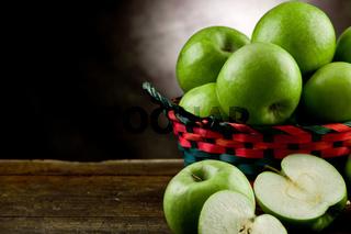 Green Apples inside a basket