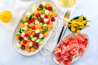 Cucumber and melon salad with raspberries and Prosciutto with grilled peppers. Summer appetizers