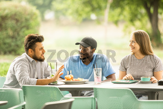 Group of young people meeting at a cafe