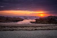 Beautiful sunset rock beach landscape peaceful relaxing with waves crashing atlantic ocean in Spain