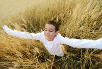 Happy child at harvest field