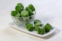 Frozen spinach in briquettes.