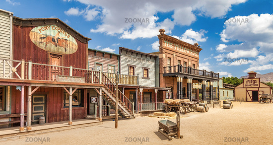 Vintage Far West town with saloon. Old wooden architecture in Wild West.
