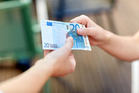 close up of hands holding euro money