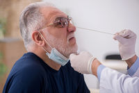 Old male patient visiting young male doctor otorhinolaryngologis