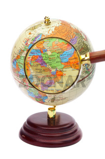 Iran, Iraq and Afghanistan on the globe under a magnifier.