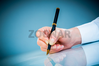 Woman's hand and pen