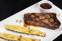 Grilled black angus steak New York