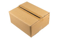 Side view of a closed cardboard box isolated on white