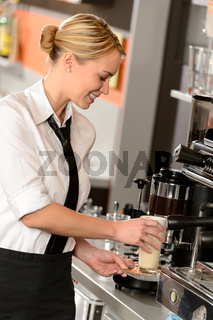 Attractive waitress making coffee with machine