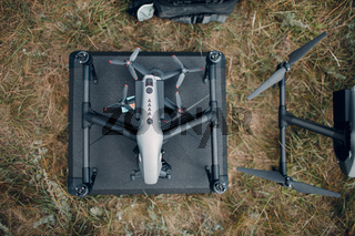 Big quadcopter drone before aerial flight and filming top view