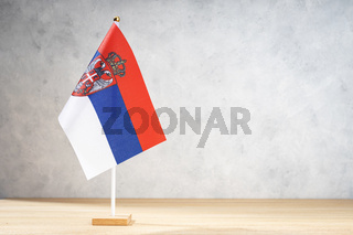 Serbia table flag on white textured wall. Copy space for text, designs or drawings