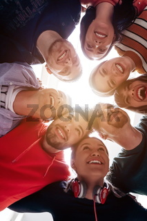 group of happy young people showing their unity