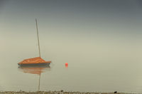 Sailboat in fog on Lake Constance. Allensbach, Baden-Wuerttemberg, Germany