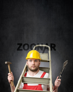 Portrait of a clumsy worker with tools