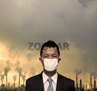 sad bussinessman with  mask and air pollution concept