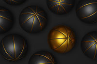 Many black basketballs with a golden basketball