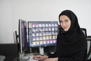 Young muslim girl working on the computer from home