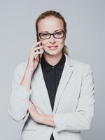 Beautiful young caucasian businesswoman talking on mobile phone.