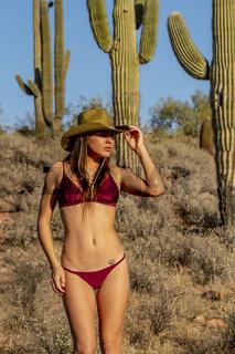 A Lovely Hispanic Model Travels Through The American Desert Enjoying The Sunny Day
