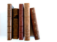 Row of old books on white background