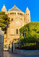 Cathedral of St. James - Cathedral of the Armenian Church in Jerusalem. Hot summer sunset. The cathedral is lit by the setting sun and clearly stands out against the blue sky. The concept of religious