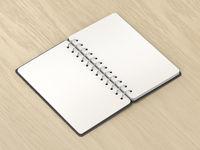 Blank notebook on wooden desk