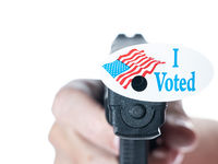 I voted today campaign button with hole on handgun for voter suppression