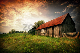 Old wooden bar with red roof over the dramatic sunset. Zalew Zegrzynski