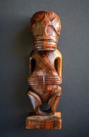 traditional wooden Polynesian tiki from Marquesas Islands
