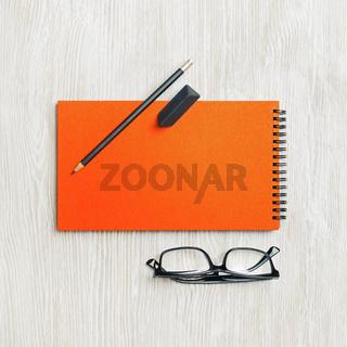 Sketchbook, glasses, pencil, eraser