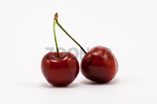 Two juicy ruby red cherries