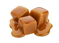 Caramel candy and caramel sauce isolated on white background