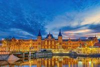 Amsterdam Netherlands, night city skyline at Amsterdam Central Station