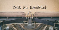 Text written with a vintage typewriter - Time to act in german - Zeit zu handeln