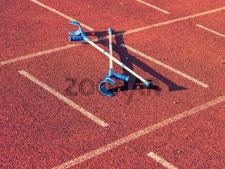 Pair of hospital crutches on stadium running track.