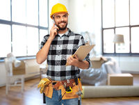builder calling on smartphone at home