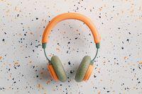 Orange and green vintage headphones 3D illustration