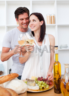 Lovers toasting with wine and cooking