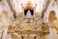 Dubrovnik, Croatia - 04 may 2016: Church of the Vlaha Church inside, in Dubrovnik, Croatia, Europe. Organ register - metal pipes decorated with gold patterns.